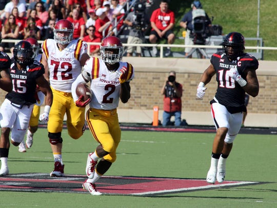 The Texas Tech Red Raiders defense chase after Iowa State Cyclones running back Mike Warren (2) in the first half at Jones AT&T Stadium. Texas Tech defeated Iowa State 66-31.