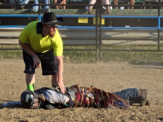 Logan Harter lays motionless after being stepped on by a bull at Lost Nations Rodeo in Marshall on June 29, 2018.