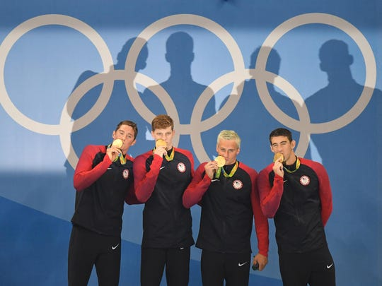 U.S. 4x200 freestyle relay team members, from left, Conor Dwyer, Townley Haas, Ryan Lochte and Michael Phelps, receive their gold medals Aug. 9 at the Olympic Aquatic Stadium in Rio de Janeiro, Brazil.
