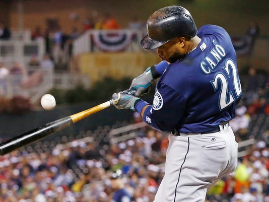 Seattle Mariners' Robinson Cano hits an RBI single off Minnesota Twins pitcher Kyle Gibson during the third inning of a baseball game Friday, Sept. 23, 2016, in Minneapolis. (AP Photo/Jim Mone)