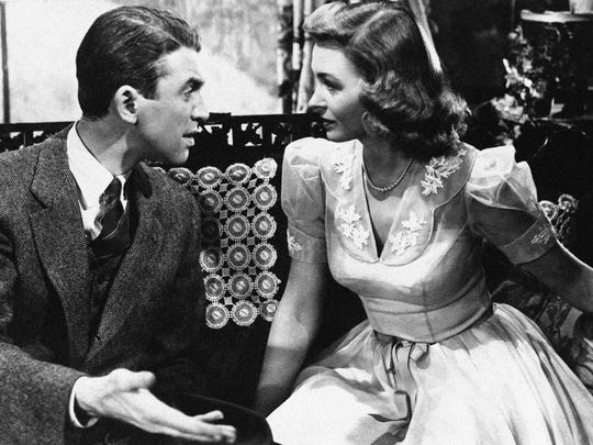 "Jimmy Stewart explains things to Donna Reed in ""It's a Wonderful Life."""