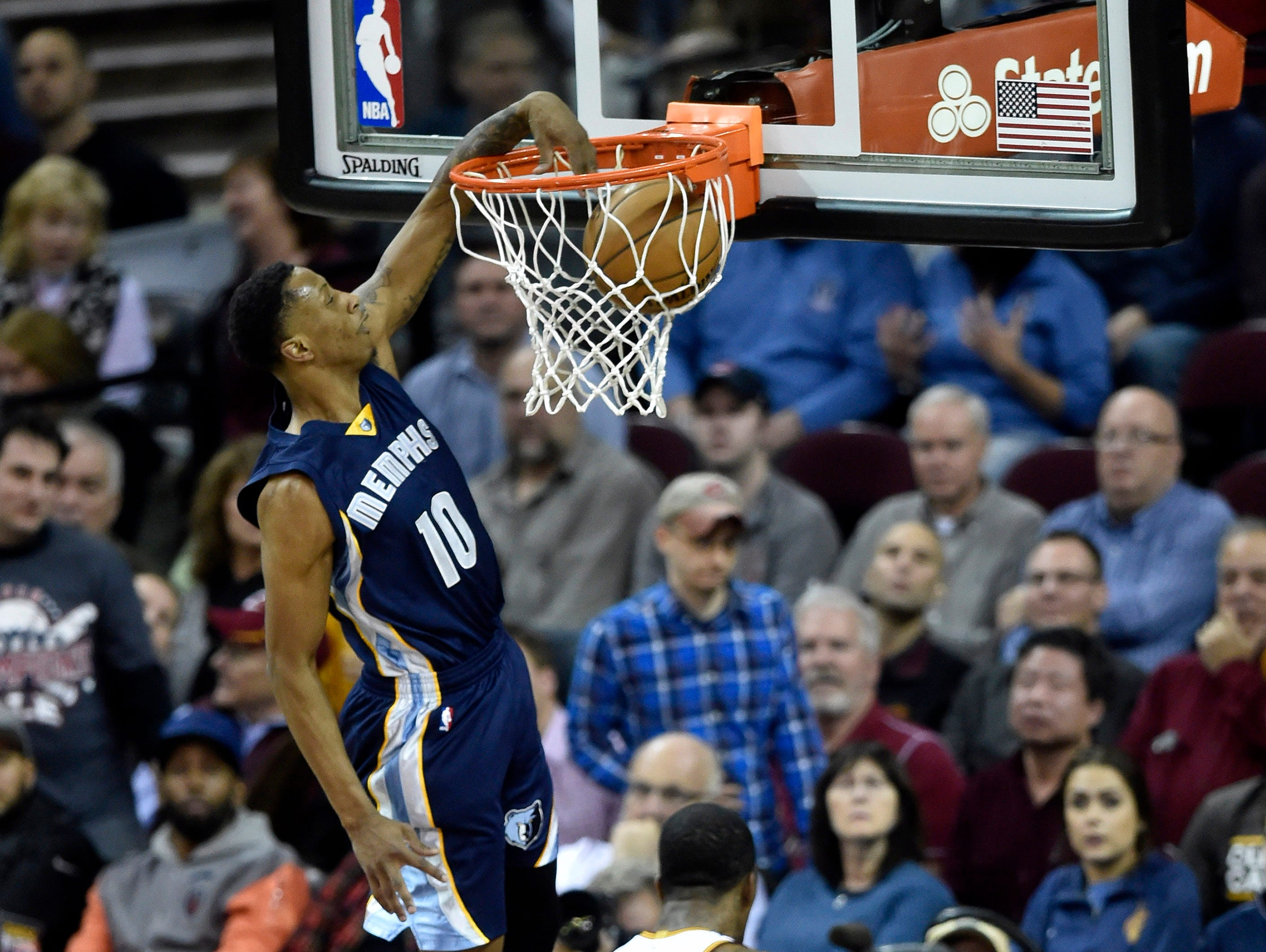 Dec 13, 2016; Cleveland, OH, USA; Memphis Grizzlies forward Troy Williams (10) dunks against the Cleveland Cavaliers in the third quarter at Quicken Loans Arena.