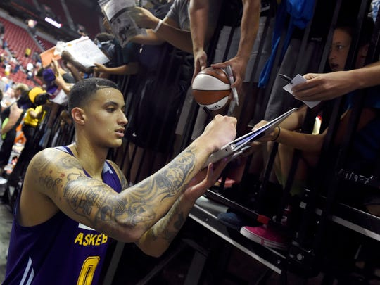 Lakers forward Kyle Kuzma signs autographs for fans