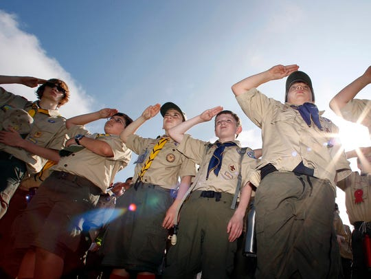 "Boy Scouts salute during a ""camporee"" in Sea Girt,"