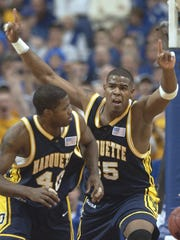 Robert Jackson (right) helped lead Marquette to the 2003 Final Four with a win over Kentucky.