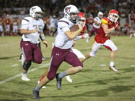 Rancho Mirage quarterback David Talley runs for a touchdown
