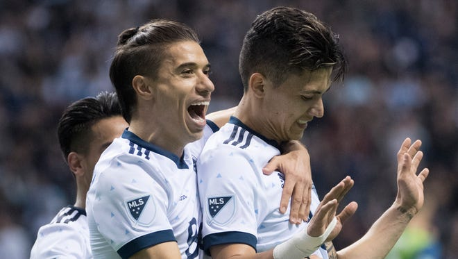 Vancouver's Fredy Montero (right) celebrates his second goal with teammates Friday.