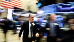 A trader works at the New York Stock Exchange, Tuesday,