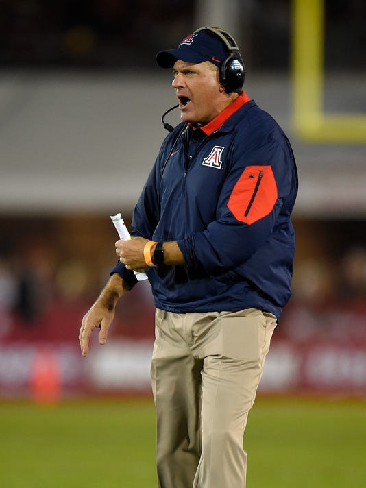 Arizona coach Rich Rodriguez yells to his team during the first half of an NCAA college football game against Southern California, Saturday, Nov. 7, 2015, in Los Angeles. (AP Photo/Mark J. Terrill)