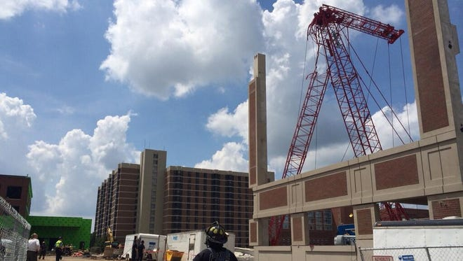 Firefighters at scene of crane incident in Rochester on Monday.