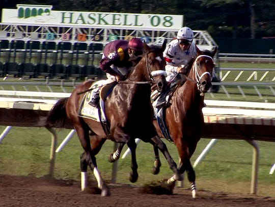 Big Brown with rider Kent Desormeaux (right) battles
