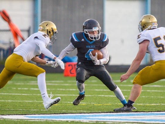 South Burlington's Andrew Cunningham tries to evade