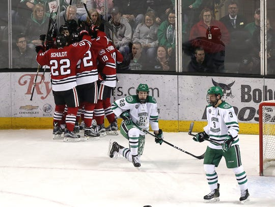 St. Cloud celebrate Jacob Benson's (17) goal in the