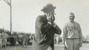 Sen. Warren G. Harding, with a cigar in his mouth, winds up to throw a pitch during the exhibition game between the Chicago Cubs and Kerrigan Tailors at Lincoln Park in Marion. Cubs owner Bill Wrigley was a Harding supporter and brought the team to Marion so Harding could see a live game.