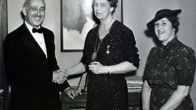 Bard College Dean Harold Mestre welcomes Eleanor Roosevelt to speak at a benefit lecture for Bard. Mrs. Edmund Hamm is on the right.