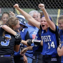 Winning Deposit  pitcher Makenzie Stiles (14) screams with joy after Kyra Martin, being hugged by Bryn Martin (3), hit a walk-off two-run home run in the eight inning to capture the Section 4 Class D title Saturday at BAGSAI Complex.