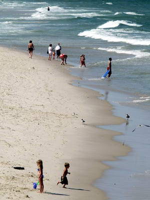 Beachgoers dip their toes into the surf in Seaside Heights.