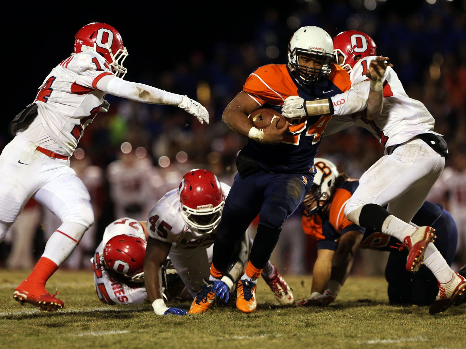 Blackman running back Charlie Davidson is hit by Oakland's Tyler Black, right, as Oakland's Cameron Newman closes in on the left in the first half of the play-off quarterfinal Friday, Nov. 21, 2014 at Blackman. Oakland won 20-9.