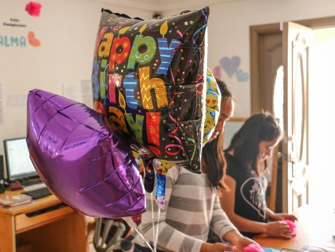 Child trafficking survivors prepare for a birthday