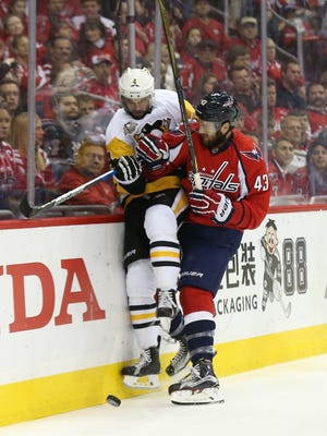 Capitals right wing Tom Wilson (43) checks Penguins defenseman Justin Schultz (4) during the first period of Game 5 of the second round of their playoff series at Verizon Center in Washington.