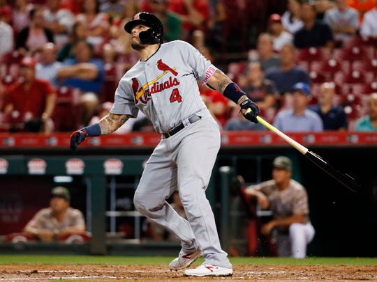 St. Louis Cardinals' Yadier Molina hits a three-run home run off Cincinnati Reds starting pitcher Jackson Stephens in the fourth inning of a baseball game, Tuesday, Sept. 19, 2017, in Cincinnati. (AP Photo/John Minchillo)