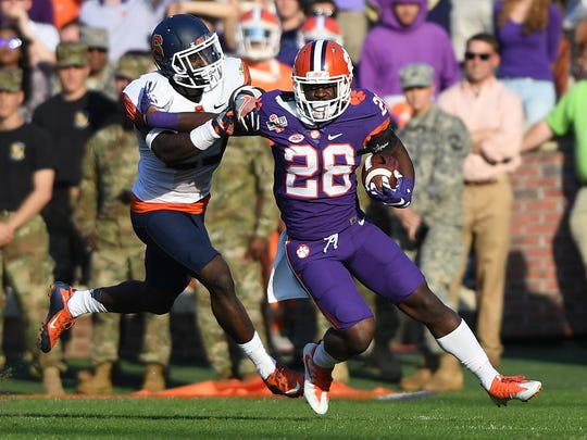 Clemson running back Tavien Feaster (28) carries during the second quarter against Syracuse on Nov. 5, 2016 at Clemson's Memorial Stadium.