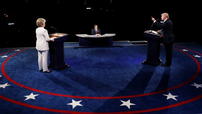 Hillary Clinton and Donald Trump take part in the third presidential debate Oct. 19 in Las Vegas.