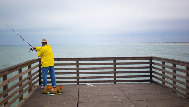 Doug Sanford casts his line into the Gulf of Mexico at Bob Hall Pier in Corpus Christi during spring break in 2015.