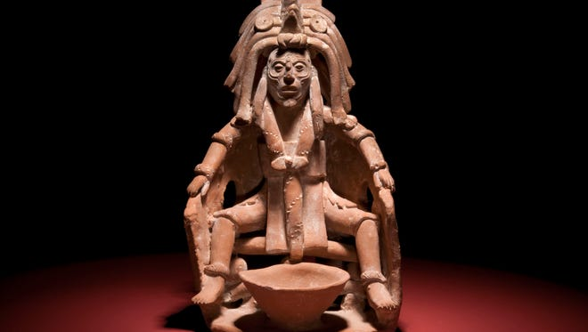 """This figure, capturing the moments before a Maya bloodletting ritual, is one of more than 250 artifacts in """"Maya: Hidden Worlds Revealed,"""" opening Saturday at the Milwaukee Public Museum."""