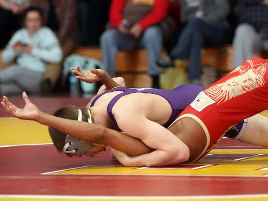 Andy Lombard of Monroe pins Julian Burke of Edison in the 113lb match, Wednesday, January 14, 2015, in Edison, NJ.Jason Towlen/Staff Photographer