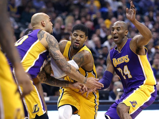 Indiana Pacers forward Paul George (13) is fouled by