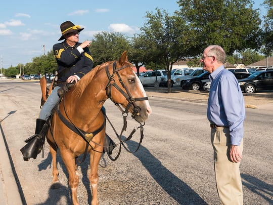 Ron Perry greets congressman Mike Conaway, after firing cannons at the Fort Concho parade grounds, to the West Texas Legislative Summit Reception held in the Fort Concho Stables July 31, 2017.