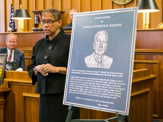U.S. District Court Chief Judge Denise Page Hood stands next to a replica of the plaque dedicated to Judge Lawrence P. Zatkoff during the plaque dedication ceremony at the federal building Oct. 2.
