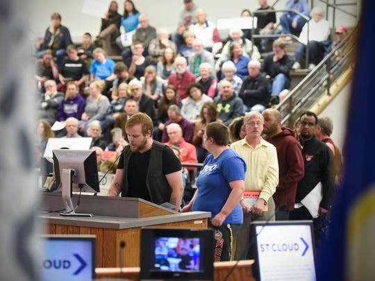 People speak during a public comment period during the St. Cloud City Council meeting Monday, Oct. 23, at city hall.