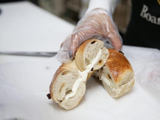 The cinnamon raisin bagel with cream cheese at Bagel
