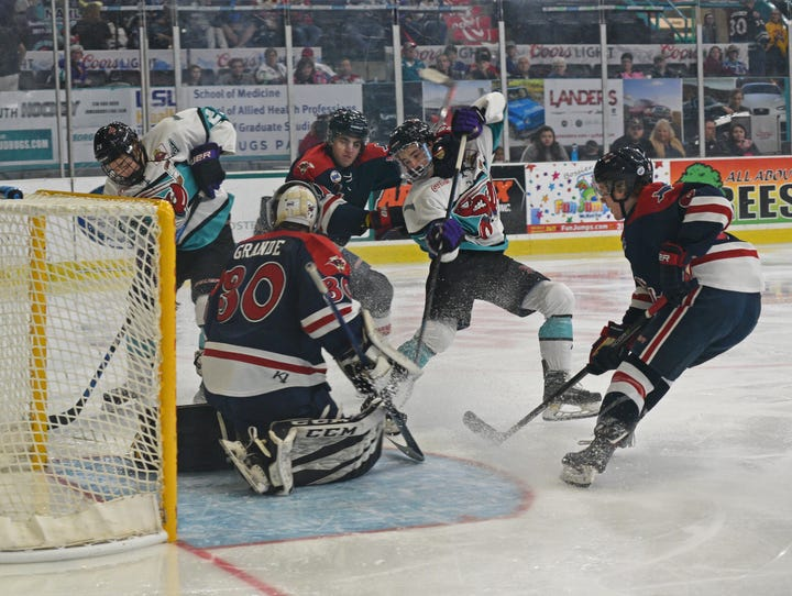 The Mudbugs fight to score in front of the goal  against