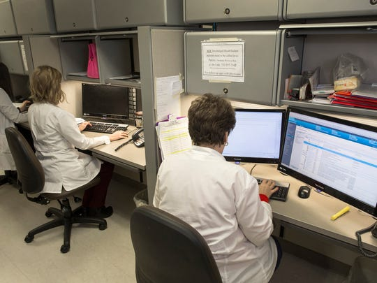 Nurses enter reports at their computers at inpatient side of the Geriatrics Center at Monmouth Medical Center's Southern Campus in Lakewood.