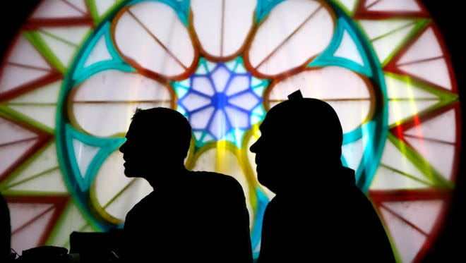 Josh Heuser of AGAR, a marketing and advertising firm, and Steve McGowan of Brave Berlin, one of minds behind Lumenocity, watch a test animation as it's projected through Music Hall's rose window.