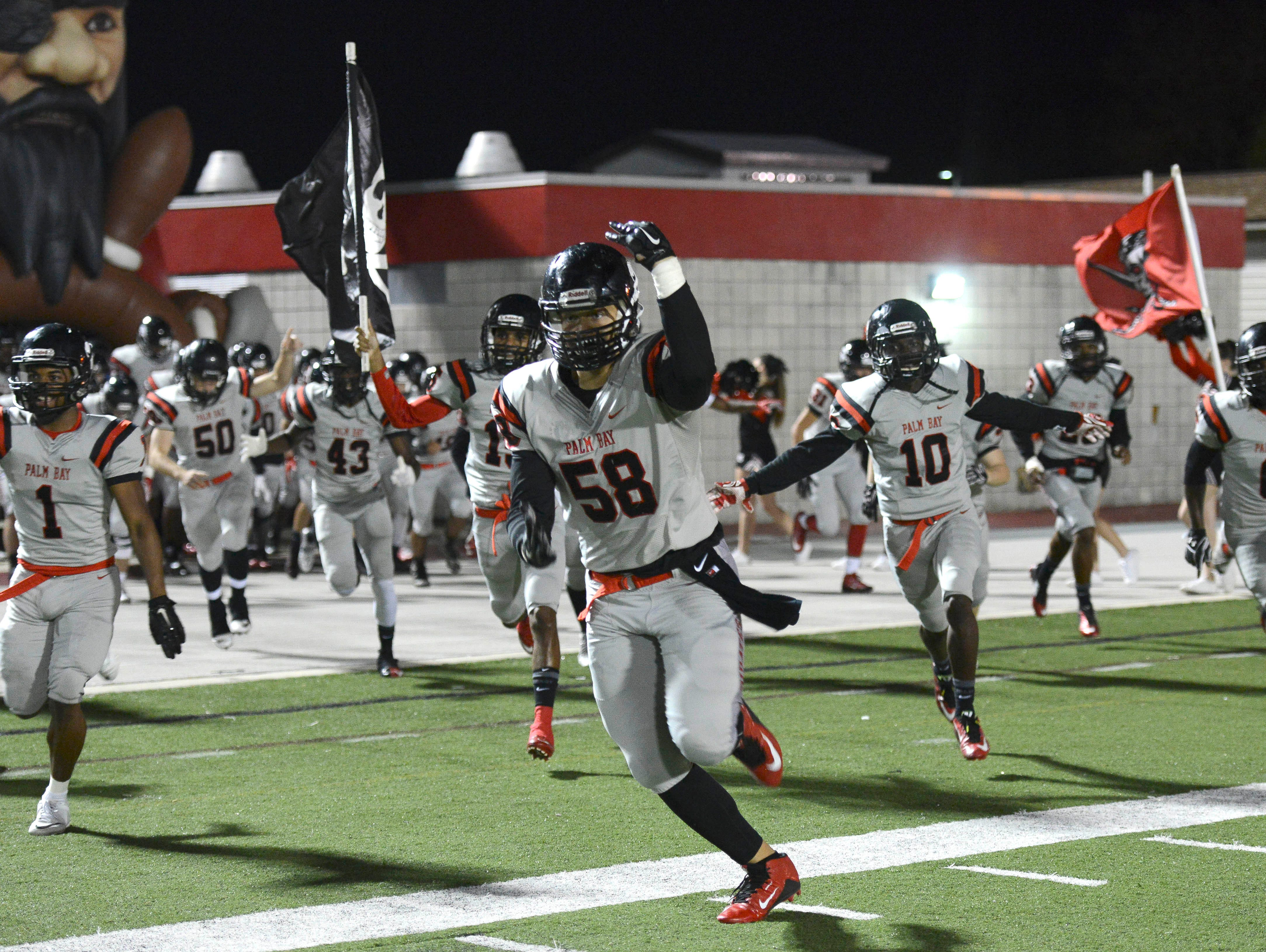 Palm Bay players take the field for Friday's game against Eustis.