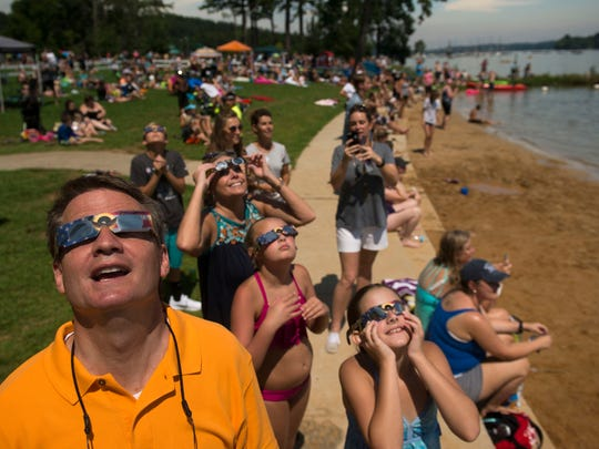 Knox County Mayor Tim Burchett watches the eclipse with his family at The Cove.
