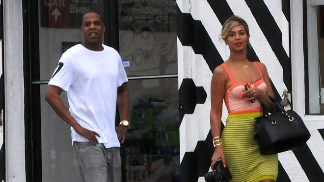 Jay Z and Beyonce are seen in Wynwood Art District on Dec. 30, 2013, in Miami.