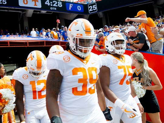 Tennessee defensive lineman Kendal Vickers (39), Tennessee defensive back Emmanuel Moseley (12) and Tennessee offensive lineman Jashon Robertson (75) walk onto the field during the Tennessee Volunteers vs. Florida Gators game at Ben Hill Griffin Stadium in Gainesville, Florida on Saturday, September 16, 2017.