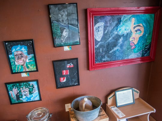 Aleah Hosea's paintings hang on the walls of Wishbone Cafe, where she is also the assistant manager, on Thursday, March 15, 2018.