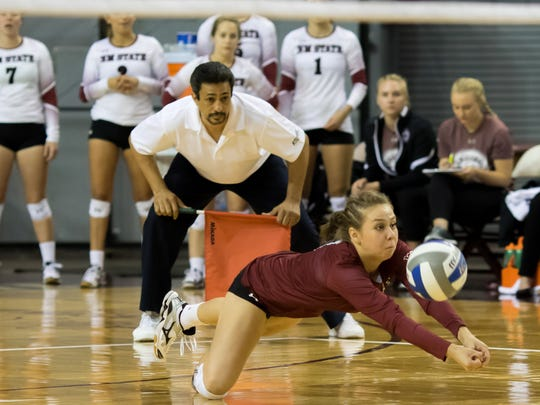 New Mexico State's Ariadnne Sierra digs a ball off