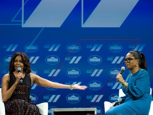 Michelle Obama, Oprah Winfrey AP