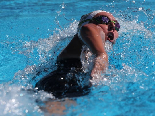 Emma Curry of Lincoln swims the 500m during the Region
