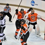 RIT players celebrate with their goalie Jordan Ruby, right, after their victory over Minnesota State Mankato.
