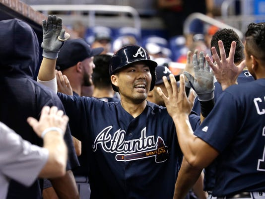 Atlanta Braves' Kurt Suzuki is congratulated after hitting a two-run home run during the third inning of a baseball game against the Miami Marlins, Sunday, Oct. 1, 2017, in Miami. (AP Photo/Lynne Sladky)