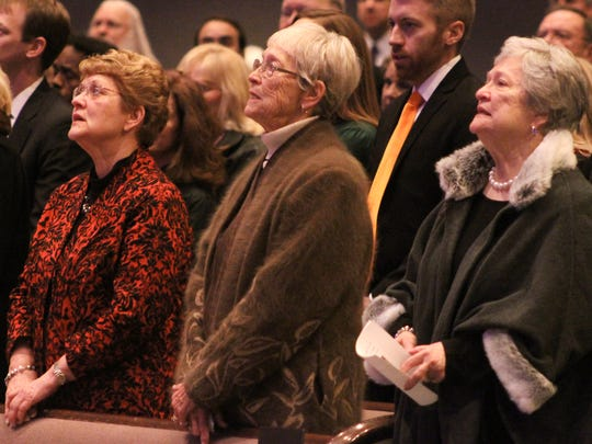 Family and friends sing 'How Great Thou Art' during a memorial service honoring former state Sen. Bobby Carter Thursday at Englewood Baptist Church in Jackson.