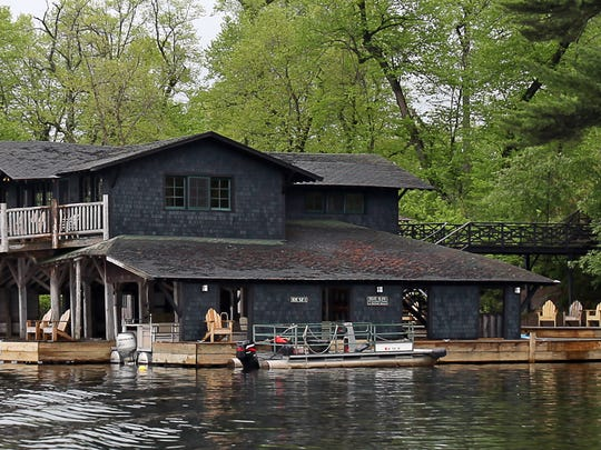 The boathouse at Stout's Island Lodge is built in the Adirondack-style and features a game room on the second floor.
